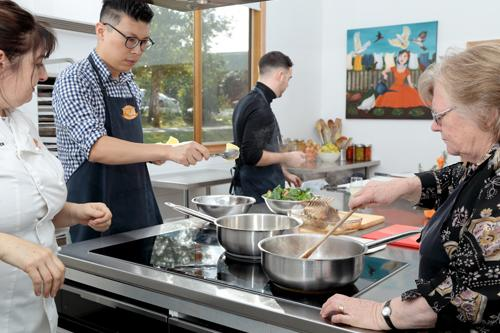 cook together at a Jacican harvest lunch